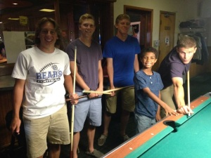 Playing pool before dinner at Sister Bay Bowl.